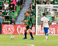 AUSTIN, TX - JUNE 19: Matt Besler #5  of Austin FC directs his teammates before passing the ball during a game between San Jose Earthquakes and Austin FC at Q2 Stadium on June 19, 2021 in Austin, Texas.