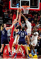 COLLEGE PARK, MD - JANUARY 26: Abi Scheid #44 of Northwestern and Kaila Charles #5 of Maryland go for the ball under the basket during a game between Northwestern and Maryland at Xfinity Center on January 26, 2020 in College Park, Maryland.