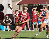 NEWTON, MA - MAY 14: Belle Mastropietro #12 of Temple University looks to pass as Molly Kearney #39 of University of Massachusetts defends during NCAA Division I Women's Lacrosse Tournament first round game between University of Massachusetts and Temple University at Newton Campus Lacrosse Field on May 14, 2021 in Newton, Massachusetts.
