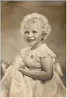 BNPS.co.uk (01202 558833)<br /> Pic: MarcusAdams/ChiswickAuctions/BNPS<br /> <br /> Princess Anne in 1953.<br /> <br /> Charming childhood photos of Princess Elizabeth and Princess Margaret have come to light, including a previously unseen image of the future Queen in a kilt.<br /> <br /> The portraits, taken by acclaimed British society photographer Marcus Adams, capture the future Queen from being a baby to her adolescence.<br /> <br /> The Queen Mother would often take her daughters to his central London studio where he would set up toys and props to keep them entertained