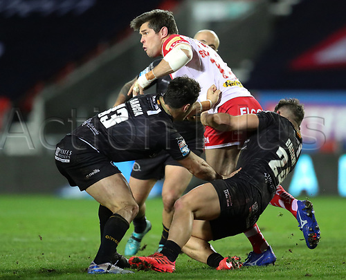 20th November 2020; Totally Wicked Stadium, Saint Helens, Merseyside, England; BetFred Super League Playoff Rugby, Saint Helens Saints v Catalan Dragons; Louie McCarthy-Scarsbrook of St Helens is tackled by Benjamin Garcia and Jason Baitieri of Catalan Dragons