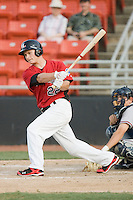 Matt West #22 of the Hickory Crawdads follows through on his swing against the Rome Braves at  L.P. Frans Stadium May 23, 2010, in Hickory, North Carolina.  The Rome Braves defeated the Hickory Crawdads 5-1.  Photo by Brian Westerholt / Four Seam Images