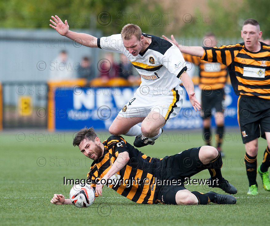 Dumbarton's Andy Graham is challenged by Alloa's Ben Gordon.