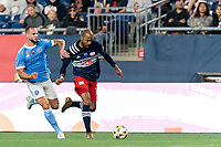 FOXBOROUGH, MA - SEPTEMBER 11: Teal Bunbury #10 of New England Revolution dribbles down the wing as Maxime Chanot #4 of New York City FC defends during a game between New York City FC and New England Revolution at Gillette Stadium on September 11, 2021 in Foxborough, Massachusetts.