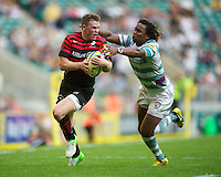 Chris Ashton of Saracens is tackled by Marland Yarde of London Irish during the Aviva Premiership match between Saracens and London Irish at Twickenham on Saturday 1st September 2012 (Photo by Rob Munro)