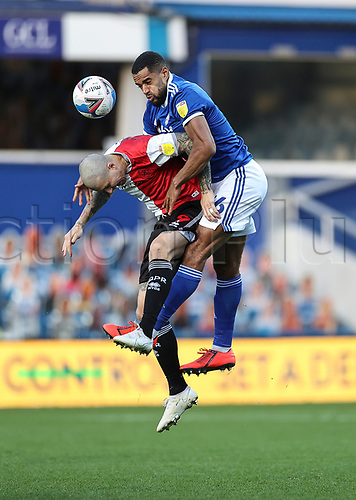 31st October 2020; The Kiyan Prince Foundation Stadium, London, England; English Football League Championship Football, Queen Park Rangers versus Cardiff City; Lyndon Dykes of QPR finds Will Vaulks of Cardiff City contesting high ball on his back