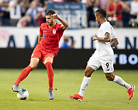 KANSAS CITY, KS - JUNE 26: Matt Miazga #19 dribbles the ball as Gabriel Torres #9 looks on during a game between Panama and USMNT at Children's Mercy Park on June 26, 2019 in Kansas City, Kansas.