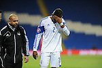 UEFA European Championship at Cardiff City Stadium - Wales v Cyprus : <br /> Dossa Junior of Cyprus is led off the field with an injury.
