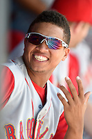 Brooklyn Cyclones third baseman Jhoan Urena (13) in the dugout during a game against the Batavia Muckdogs on August 10, 2014 at Dwyer Stadium in Batavia, New York.  Brooklyn defeated Batavia 5-2.  (Mike Janes/Four Seam Images)