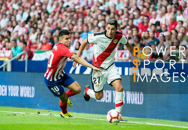 Santiago Comesana, Santi Comesana (R), of Rayo Vallecano fights for the ball with Angel Correa of Atletico de Madrid during the La Liga 2018-19 match between Atletico de Madrid and Rayo Vallecano at Wanda Metropolitano on August 25 2018 in Madrid, Spain. Photo by Diego Souto / Power Sport Images