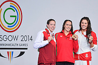 Brooklynn Snodgrass of CAN bronze, Georgia Davies of WAL gold and Lauren Quigley of ENG during award ceremony for women's 50 meter backstroke final, Tuesday, July 29, 2014 in Glasgow, United Kingdom. (Mo Khursheed/TFV Media via AP Images)