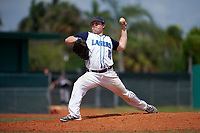 Lasell Lasers pitcher Brian Cohen (15) delivers a pitch during the first game of a doubleheader against the Edgewood Eagles on March 14, 2016 at Terry Park in Fort Myers, Florida.  Edgewood defeated Lasell 10-2.  (Mike Janes/Four Seam Images)