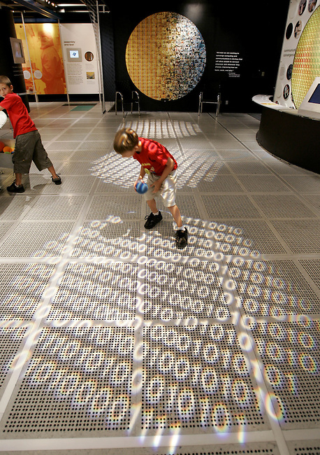 Kids play in the Intel Museum at Intel Corp. headquarters in Santa Clara, Calif., Monday, July 17, 2006. All digital information is made up of 0 and 1 as explained in this museum exhibit. Intel Corp., the world's biggest maker of microchips, is expected to post a second-quarter profit of 13 cents a share on sales of $8.27 billion, the average estimates in a Thomson Financial survey of analysts.  (AP Photo/Paul Sakuma)