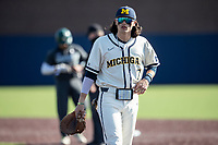 Michigan Wolverines first baseman Jake Marti (7) in action against the Michigan State Spartans on March 21, 2021 in NCAA baseball action at Ray Fisher Stadium in Ann Arbor, Michigan. Michigan scored 8 runs in the bottom of the ninth inning to defeat the Spartans 8-7. (Andrew Woolley/Four Seam Images)