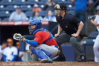 Buffalo Bison catcher Reese McGuire (3) sets a target as home plate umpire Richard Riley looks on during the game against the Durham Bulls at Durham Bulls Athletic Park on April 25, 2018 in Allentown, Pennsylvania.  The Bison defeated the Bulls 5-2.  (Brian Westerholt/Four Seam Images)