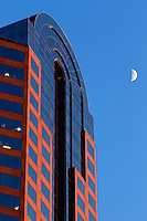 A cresent moon rises overhead near the Wells Fargo tower in downtown Charlotte, NC.
