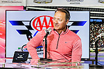 Texas Rangers general manager, Jeff Banister, conducts an interview before the NASCAR AAA Texas 500 race at Texas Motor Speedway in Fort Worth,Texas.