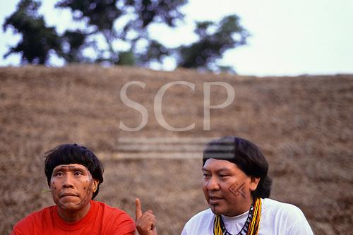 Amazon, Brazil. Yanomami shaman Levi and leader Davi at a gathering.