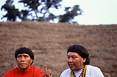 Amazon, Brazil. Yanomami shaman Levi and leader Davi at a gathering.