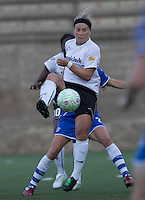 magicJack forward Ella Masar (55) redirects the ball. In a Women's Professional Soccer (WPS) match, the Boston Breakers defeated magicJack, 2-1, at Harvard Stadium on June 5, 2011.