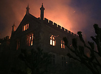 Bmth News (01202 558833)<br /> Pic:  CraigBaker/DWFRS/BNPS<br /> <br /> Historic Manor owned by Austrian Hedgefund manager Michael Treichl and his wife Emma, has been destroyed by fire.<br /> <br /> Parnham House in Dorset, an historic Grade I listed Tudor mansion, has been gutted by fire as detectives launch an investigation into possible arson.<br /> <br /> Twenty fire engines rushed to put out the blaze near Beaminster, Dorset, in the early hours of Saturday morning.<br /> <br /> But an eyewitness said it looks like the entire roof is gone as the 16th century stately home continued to smoke more than six hours later.<br /> <br /> Detectives are now investigating the cause of the fire and a police spokesman said suspicious circumstances cannot be ruled out.