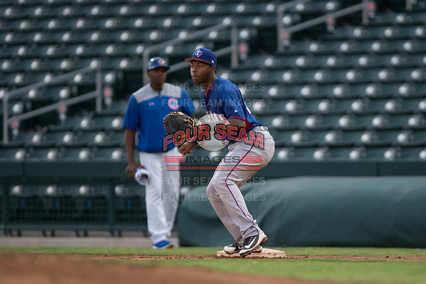 AZL Rangers first baseman Stanley Martinez (29) waits to receive a throw during an Arizona League game against the AZL Cubs 2 at Sloan Park on July 7, 2018 in Mesa, Arizona. AZL Rangers defeated AZL Cubs 2 11-2. (Zachary Lucy/Four Seam Images)