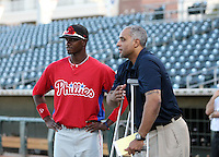 Domonic Brown of the Scottsdale Scorpions, 2009 Arizona Fall League talking with former major league player Tony Clark before the annual Rising Stars game at Surprise, AZ - 11/07/2009..Photo by:  Bill Mitchell/Four Seam Images..