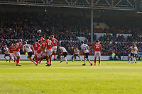 Matt Grimes of Swansea City (R) takes a free kick during the Sky Bet Championship match between Nottingham Forest and Swansea City at City Ground, Nottingham, England, UK. Saturday 30 March 2019