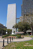 New Orleans, Louisiana.  Lafayette Square.  Statue to John McDonogh, a 19th. Century Philanthropist who Funded New Orleans Public Schools.  Tall Office Building in Background is One Shell Square.