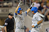 UCLA Bruin pinch runner Christoph Bono (3) scores the winning run in the eighth inning of Game 4 of the 2013 Men's College World Series against the LSU Tigers on June 16, 2013 at TD Ameritrade Park in Omaha, Nebraska. UCLA defeated LSU 2-1. (Andrew Woolley/Four Seam Images)