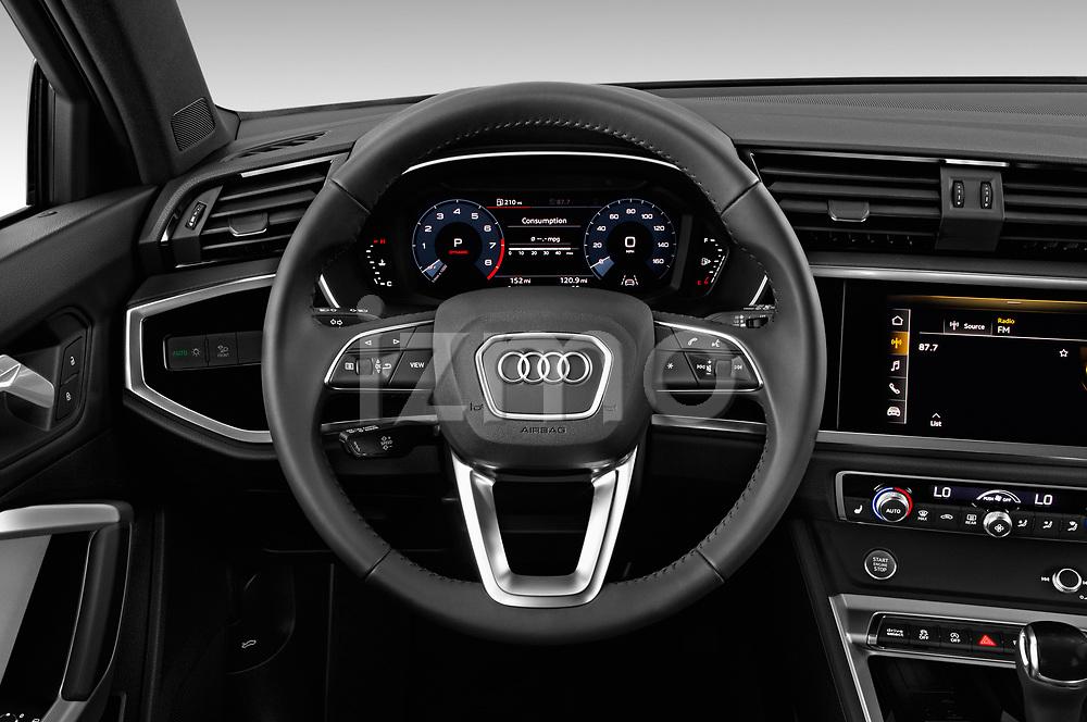 Car pictures of steering wheel view of a 2019 Audi Q3 Premium Plus 5 Door SUV