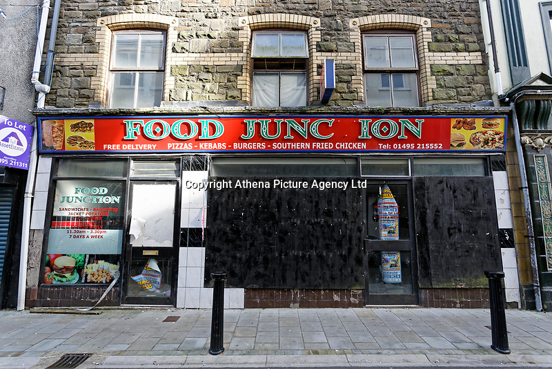 Pictured: The deserted Food Junction restaurant in Clarence Street, Abertillery, Blaenau Gwent, Wales, UK. Tuesday 23 October 2018<br /> Re: 73% of all restaurants in one part of Wales are selling fast food, according to a survey.<br /> Blaenau Gwent tops the UK with 55 out of 75 outlets takeaway venues.<br /> Caerphilly has second highest proportion of take-away with 66%, Rhondda Cynon Taff is number four in the UK with 63%.<br /> Wales has had 670 fast food outlets open in the past eight years, with Neath Port Talbot seeing its numbers more than double from 50 to 105.