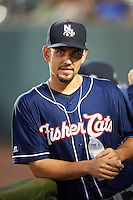 New Hampshire Fisher Cats pitcher Taylor Cole (19) in the dugout during a game against the Harrisburg Senators on July 21, 2015 at Metro Bank Park in Harrisburg, Pennsylvania.  New Hampshire defeated Harrisburg 7-1.  (Mike Janes/Four Seam Images)