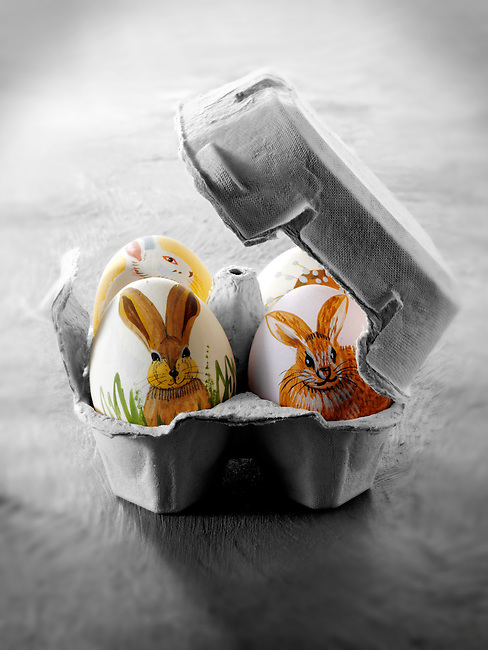 Hand painted chicken eggs with traditional Easter bunny design