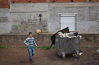 Serbia. Leskovac is a city and the administrative center of the Jablanica District in southern Serbia. «Petar Tasir» Elementary School. The school's students are all from Romani ethnicity. A Roma boy plays football on the school yard. A waste container is full with rubbish. Graffitis on the wall. The Romani (also spelled Romany) or Roma, Roms or Gypsies, are a traditionally itinerant ethnic group. The Pestalozzi Children's Foundation (Stiftung Kinderdorf Pestalozzi) is advocating access to high quality education for underprivileged children. It supports in Leskovac a project called» Together in transition».18.4.2018 © 2018 Didier Ruef for the Pestalozzi Children's Foundation