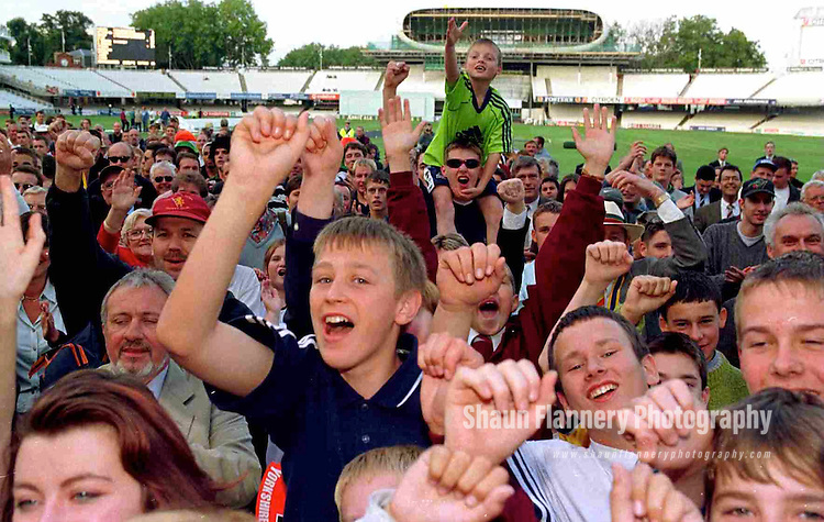 Pix: Shaun Flannery/shaunflanneryphotography.com...COPYRIGHT PICTURE>>SHAUN FLANNERY>01302-570814>>07778315553>>..28th August 1998..............Doncaster Town v Bath..Abbot Ale Cup final at Lords..Doncaster Town fans celebrate the teams victory in the Abbots Ale Cup after a thrilling game against Bath.