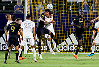 CARSON, CA - SEPTEMBER 06: Mark-Anthony Kaye #14 of LAFC and Daniel Steres #5 of the Los Angeles Galaxy go head to head for a ball in the front of the goal during a game between Los Angeles FC and Los Angeles Galaxy at Dignity Health Sports Park on September 06, 2020 in Carson, California.