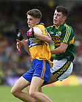 Colin Mc Neilis of Clare in action against Adam Donoghue of Kerry during their Minor Munster final at Killarney.  Photograph by John Kelly.