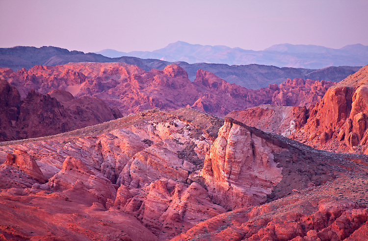 Aztec sandstone rock formations take on dusk's pastel colors in Valley of Fire State Park in Nevada, USA