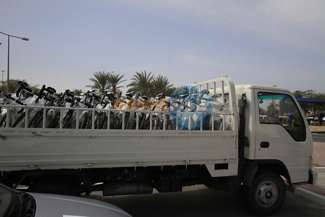 Team bikes arrive in the back of pick up trucks before the start of the 3rd Stage of the 2012 Tour of Qatar running 146.5km from Dukhan Souq, Dukhan to Al Gharafa, Qatar. 7th February 2012.<br /> (Photo Eoin Clarke/Newsfile)