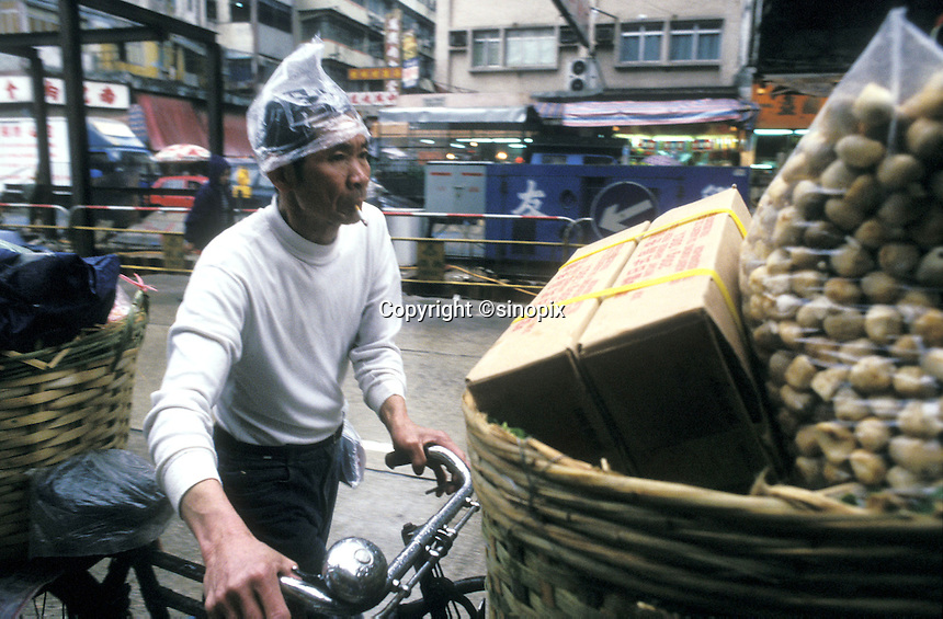 Delivery worker on the bicycle in Hong Kong.