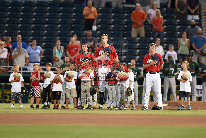 Fort Myers Miracle Bryan Haar (23), Aaron Slegers (31) and Logan Wade (4) with baseball campers on the field before a game against the Daytona Tortugas on June 18, 2015 at Hammond Stadium in Fort Myers, Florida.  Fort Myers defeated Daytona 4-1.  (Mike Janes/Four Seam Images)