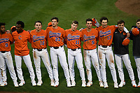 Members of the Clemson Tigers, including Jordan Greene, Bo Majkowski, Carson Spires, Michael Green, Sam Hall and Bryce Teodosio, stand together as they sing the school's Alma Mater following in a game against the South Alabama Jaguars on Opening Day, Friday, February 15, 2019, at Doug Kingsmore Stadium in Clemson, South Carolina. Clemson won, 6-2. (Tom Priddy/Four Seam Images)