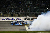 Monster Energy NASCAR Cup Series<br /> Go Bowling 400<br /> Kansas Speedway, Kansas City, KS USA<br /> Saturday 13 May 2017<br /> Martin Truex Jr, Furniture Row Racing, Auto-Owners Insurance Toyota Camry celebration<br /> World Copyright: Barry Cantrell<br /> LAT Images<br /> ref: Digital Image 17KAN1bc4774
