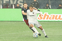 FOXBOROUGH, MA - NOVEMBER 1: Yamil Asad #11 of DC United brings the ball forward with Thomas McNamara #26 of New England Revolution in pursuit during a game between D.C. United and New England Revolution at Gillette Stadium on November 1, 2020 in Foxborough, Massachusetts.