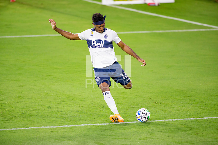 LOS ANGELES, CA - SEPTEMBER 23: Derek Cornelius #13 of the Vancouver Whitecaps sends a ball during a game between Vancouver Whitecaps and Los Angeles FC at Banc of California Stadium on September 23, 2020 in Los Angeles, California.