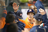 Houston Astros third baseman Matt Dominguez (30) is greeted in the Astros dugout after scoring in the seventh inning of the MLB baseball game against the Detroit Tigers on May 3, 2013 at Minute Maid Park in Houston, Texas. Detroit defeated Houston 4-3. (Andrew Woolley/Four Seam Images).