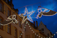 festive street Christmas lights with angel and stars