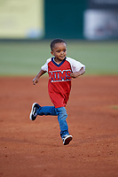 A young fan runs the bases during a Mobile BayBears game against the Pensacola Blue Wahoos on April 25, 2017 at Hank Aaron Stadium in Mobile, Alabama.  Mobile defeated Pensacola 3-0.  (Mike Janes/Four Seam Images)