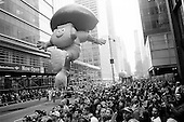 New York,New York<br /> November 26, 2009<br /> USA<br /> <br /> The Macy's Thanksgiving Day Parade in mid-town Manhattan, as Dora the Explorer and other children's cartoon character balloons float through the skyscrapers on 6th Avenue and 42nd Street. Crowds gather to mark the beginning of the Christmas season.